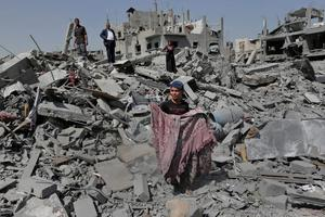 Palestinians salvage belongings from the rubble of their destroyed house in the heavily bombed town of Beit Hanoun, Gaza Strip, close to the Israeli border, Friday, Aug. 1, 2014.  (AP Photo/Lefteris Pitarakis)