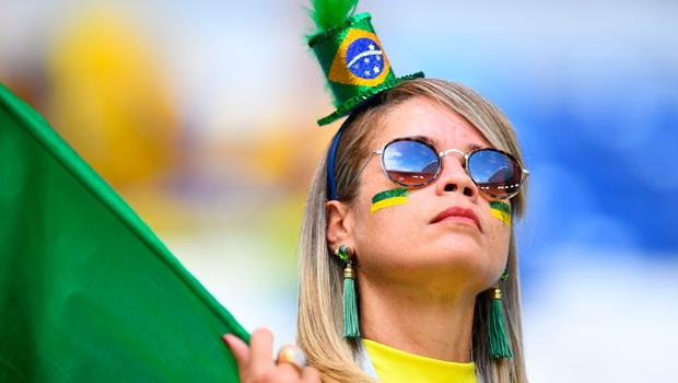 A Brazil's fans cheers prior to the Russia 2018 World Cup round of 16 football match between Brazil and Mexico at the Samara Arena in Samara on July 2, 2018. / AFP PHOTO / MANAN VATSYAYANA / RESTRICTED TO EDITORIAL USE - NO MOBILE PUSH ALERTS/DOWNLOADSMANAN VATSYAYANA/AFP/Getty Images