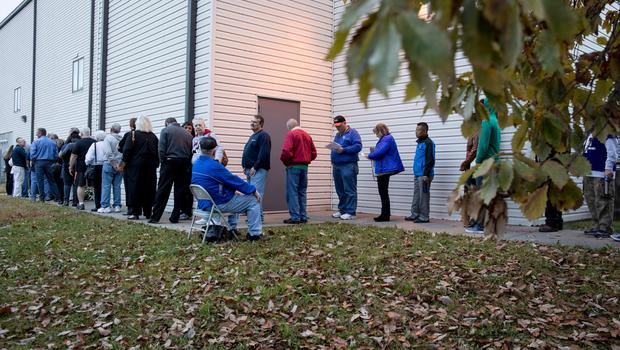 KANSAS CITY, MO - NOVEMBER 08:  Voters wait in line to cast their ballots on November 8, 2016 Kansas City, Missouri. Americans will choose between Republican presidential candidate Donald Trump and Democratic presidential candidate Hillary Clinton today as they vote for the next president of the United States.  (Photo by Whitney Curtis/Getty Images)