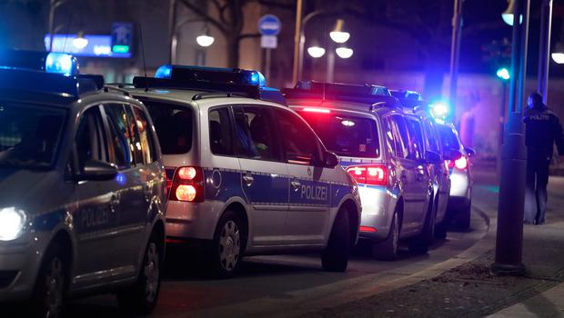 BERLIN, GERMANY - DECEMBER 19:  Police cars line up the area after a lorry truck ploughed through a Christmas market on December 19, 2016 in Berlin, Germany. Several people have died while dozens have been injured as police investigate the attack at a market outside the Kaiser Wilhelm Memorial Church on the Kurfuerstendamm and whether it is linked to a terrorist plot.  (Photo by Sean Gallup/Getty Images)