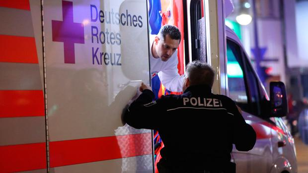 BERLIN, GERMANY - DECEMBER 19:  Police speak to an ambulance near the area after a lorry truck ploughed through a Christmas market on December 19, 2016 in Berlin, Germany. Several people have died while dozens have been injured as police investigate the attack at a market outside the Kaiser Wilhelm Memorial Church on the Kurfuerstendamm and whether it is linked to a terrorist plot.  (Photo by Sean Gallup/Getty Images)