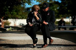 ARLINGTON, VA - SEPTEMBER 11:  Betsy Wolk (L) and her husband Herb Wolk (R) of Columbia, Maryland, remember their son-in-law Lt. Darin H. Pontell, who lost his life during the 9/11 Pentagon attack, prior to an observance ceremony at the Pentagon Memorial September 11, 2015 in Arlington, Virginia. The nation remembered the lives that were lost in the 9/11 attacks on its 14th anniversary.  (Photo by Alex Wong/Getty Images)