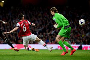 LONDON, ENGLAND - APRIL 28:  Laurent Koscielny of Arsenal (6) beats goalkeeper Tim Krul of Newcastle United to score their first goal during the Barclays Premier League match between Arsenal and Newcastle United at Emirates Stadium on April 28, 2014 in London, England.  (Photo by Jamie McDonald/Getty Images)