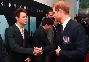 Prince Harry (right) shakes hands with Harry Styles as he attends the world premiere of Christopher Nolan's epic Second World War movie Dunkirk at the Odeon Leicester Square in London. (Eamonn M McCormack/PA Wire)