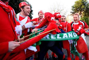 DUBLIN, IRELAND - FEBRUARY 08: An Ireland fan is mobbed by Welsh dragons during RBS Six Nations match between Ireland and Wales at the Aviva Stadium on February 8, 2014 in Dublin, Ireland. (Photo by Alan Crowhurst/Getty Images)