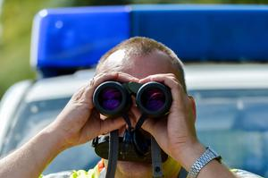 A police officer uses binoculars at a check point during control on the border crossing between Austria and Germany at the southern German city of Kiefersfelden on September 16, 2015 as tens of thousands of migrants have entered Germany from Hungary via Austria in recent weeks. Germany took the drastic measure of reinstating border controls on September 13, 2015 after being overwhelmed by a surge in asylum-seekers. AFP PHOTO / GUENTER SCHIFFMANNGUENTER SCHIFFMANN/AFP/Getty Images