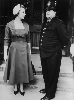 British politician Margaret Thatcher talks to a policeman outside the House of Commons, where she is taking her seat as the Member of Parliament for Finchley, 20th October 1959. (Photo by Hulton Archive/Getty Images)