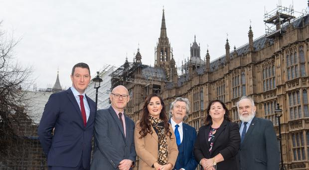 Recently elected Sinn Fein MPs (left to right) John Finucane, Paul Maskey, Orfhlaith Begley, Mickey Brady, Michelle Gildernew, and Francie Molloy, outside the Houses of Parliament (Dominic Lipinski/PA)