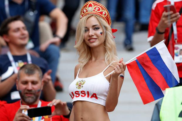 A fan of Russia prior to the round of 16 match between Spain and Russia at the 2018 soccer World Cup at the Luzhniki Stadium in Moscow, Russia, Sunday, July 1, 2018. (AP Photo/Antonio Calanni)