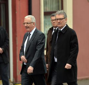 Ulster Unionist leader Mike Nesbitt and party colleague Danny Kennedy at the funeral for murdered prison officer Adrian Ismay arrives at Woodvale Methodist Church