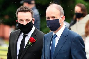 Taoiseach Micheal Martin (right) alongside leader of the SDLP Colum Eastwood as they arrive at St Eugene's Cathedral in Londonderry for the funeral of John Hume. PA Photo. Picture date: Wednesday August 5, 2020. Hume was a key architect of Northern Ireland's Good Friday Agreement and was awarded the Nobel Peace Prize for the pivotal role he played in ending the region's sectarian conflict. He died on Monday aged 83, having endured a long battle with dementia. See PA story FUNERAL Hume. Photo credit should read: Niall Carson/PA Wire