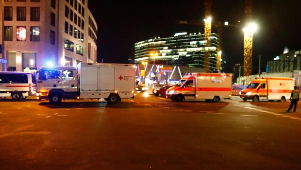 Ambulances arrive at the scene where a truck speeded into a christmas market in Berlin, on December 19, 2016 killing nine persons and injuring at least 50 people. / AFP PHOTO / Odd ANDERSENODD ANDERSEN/AFP/Getty Images