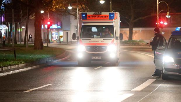 BERLIN, GERMANY - DECEMBER 19:  An ambulance drives near the area after a lorry truck ploughed through a Christmas market on December 19, 2016 in Berlin, Germany. Several people have died while dozens have been injured as police investigate the attack at a market outside the Kaiser Wilhelm Memorial Church on the Kurfuerstendamm and whether it is linked to a terrorist plot.  (Photo by Sean Gallup/Getty Images)