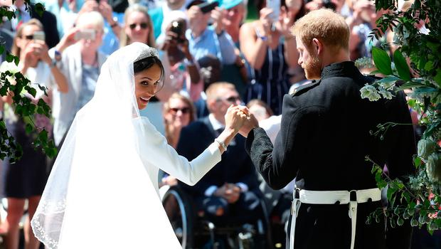 Prince Harry and Meghan Markle on the steps of St George's Chapel in Windsor Castle after their wedding. PRESS ASSOCIATION Photo. Picture date: Saturday May 19, 2018. See PA story ROYAL Wedding. Photo credit should read: Danny Lawson/PA Wire