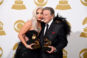 "Lady Gaga, left, and Tony Bennett pose in the press room with the award for best traditional pop vocal album for ""Cheek to Cheek"" at the 57th annual Grammy Awards at the Staples Center on Sunday, Feb. 8, 2015, in Los Angeles. (Photo by Chris Pizzello/Invision/AP)"
