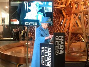 The Queen pictured sending her first tweet during a visit to the Science Museum
