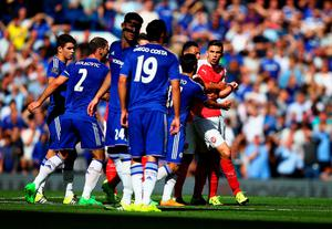 LONDON, ENGLAND - SEPTEMBER 19:  Gabriel (1st R) of Arsenal is blocked by Chelsea players as he tries to walk toward Diego Costa of Chelsea after being shown a red card during the Barclays Premier League match between Chelsea and Arsenal at Stamford Bridge on September 19, 2015 in London, United Kingdom.  (Photo by Ian Walton/Getty Images)