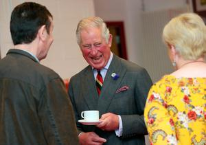 The Prince of Wales at the Eglinton Community Centre in Londonderry during a visit to communities hit by the summer's flash floods. Laura Hutton/PA Wire