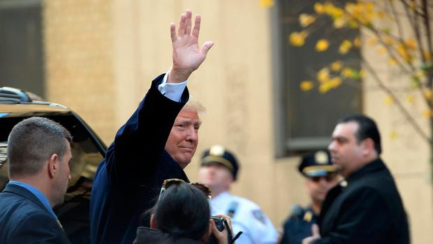 Republician presidential nominee Donald Trump waves he leaves after voting in the presidential election at a polling station in New York,  November 8, 2016. / AFP PHOTO / Robyn BeckROBYN BECK/AFP/Getty Images