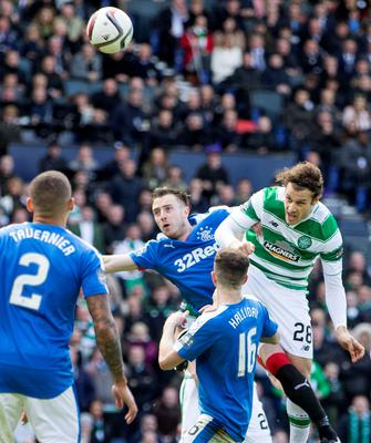 Celtic's Erik Sviatchenko (right) scores his sides opening goal during the William Hill Scottish Cup semi-final match at Hampden Park, Glasgow. PRESS ASSOCIATION Photo. Picture date: Sunday April 17, 2016. See PA story SOCCER Rangers. Photo credit should read: Jeff Holmes/PA Wire. EDITORIAL USE ONLY