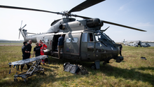 MERCY MISSION: Members of the UK Armed Forces work with NHS medical staff and Air Ambulance Service crews onboard a Puma HC2 helicopter at Thruxton Aerodrome in Andover, England.