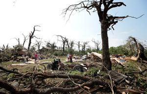 SHAWNEE, OK - MAY 20:  ers help with cleanup of Tom and Ronda Clark's property after it was damaged by a tornadMay 20, 2013 near Shawnee, Oklahoma. A series of tornados moved across central Oklahoma May 19, killing two people and injuring at least 21. (Photo by Brett Deering/Getty Images)