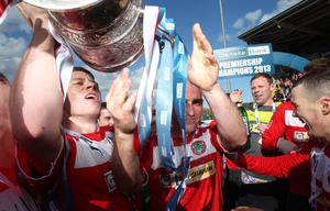 Celebration as Danske Bank Premiership Champions Cliftonville lift the Gibson Cup.   Cliftonville's Stephen Garrett, Barry Johnston and Martin Donnelly