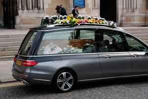 The hearse carrying the body of murdered journalist Lyra McKee arrives at St Anne's Cathedral in Belfast.