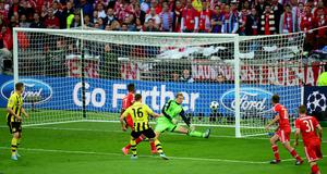 Borussia Dortmund's Jakub Blaszczykowski (16) has his shot saved by Bayern Munich goalkeeper Manuel Neuer during the UEFA Champions League Final at Wembley Stadium, London. PRESS ASSOCIATION Photo. Picture date: Saturday May 25, 2013.
