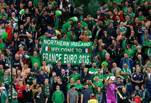 "Northern Ireland fans wave a banner in the stands reading ""Northern Ireland welcome to France Euro 2016"" during the UEFA European Championship Qualifying match at Windsor Park, Belfast. PRESS ASSOCIATION Photo. Picture date: Thursday October 8, 2015. See PA story SOCCER N Ireland. Photo credit should read: Niall Carson/PA Wire."