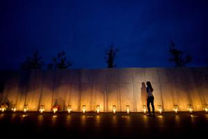 SHANKSVILLE, PA- SEPTEMBER 10:  Visitors walk along the wall of names of passengers who perished in the 9/11 terrorist attacks on the eve of the 13th anniversary of the attacks at the Flight 93 National Memorial Visitor Center Complex September 10, 2014  in Shanksville, Pennsylvania. Ceremonies are scheduled for tomorrow.  (Photo by Jeff Swensen/Getty Images)