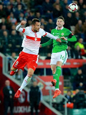 Northern IrelandÕs Oliver Norwood and Switzerland's Haris Seferovic in action during the World Cup qualifying playoff at Windsor Park on November 9th 2017   (Photo by Kevin Scott / Belfast Telegraph)