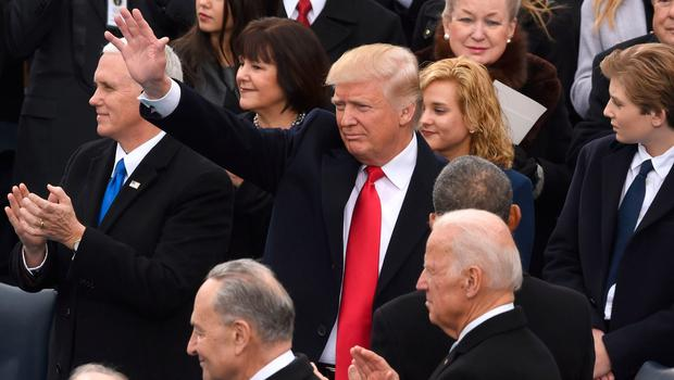 US President elect Donald Trump (C) arrives for the swearing-in ceremony on in front of the Capitol in Washington on January 20, 2017.  / AFP PHOTO / Timothy A. CLARYTIMOTHY A. CLARY/AFP/Getty Images
