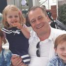 Conor (aged 9), Darragh (7) and Carla (3) McGinley with their father