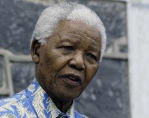 """CAPE TOWN, SOUTH AFRICA - NOVEMBER 28:  Nelson Mandela at a press conference for """"46664 - Give One Minute of Your Life to AIDS"""" on Robben Island where he was impisoned for 18 years November 28, 2003 off the coast of Cape Town, South Africa. The concert will take place at Greenpoint Stadium on November 29, 2003 and will benefit the Nelson Mandela Foundation and the fight against AIDS in Africa. Artists performing will include Bono, Queen, Peter Gabriel, The Eurythmics, Beyonce, Youssou N'Dour and many other international and African musicians. It will be one of the biggest rock events ever staged in Africa and will also be the most widely distributed media event in history with a potential audience of more than 2 billion people in 166 countries.  (Photo by Frank Micelotta/Getty Images) *** Local Caption *** Nelson Mandela"""