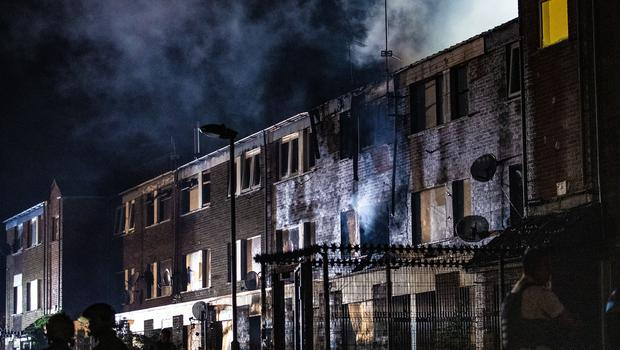 Emergency services deal with a fire at a block of flats on Ross Street in west Belfast on June 21, 2021 (Photo by Kevin Scott for Belfast Telegraph)