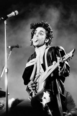 This black and white photo taken on June 17, 1987 shows musician Prince performing onstage during his concert at the Bercy venue in Paris.   Pop icon Prince -- whose pioneering brand of danceable funk made him one of music's most influential figures -- died Thursday at his compound in Minnesota. He was 57. The announcement came just a week after the Grammy and Oscar winner was taken to hospital with a bad bout of influenza, although he made light of his health problems after the scare.   / AFP PHOTO / Bertrand GUAYBERTRAND GUAY/AFP/Getty Images