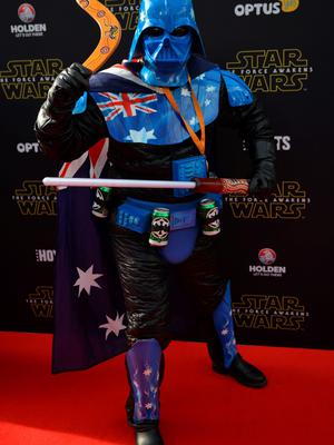 A fan dressed as a Star Wars character arrives at the Australian premier of 'Star Wars: The Force Awakens' in Sydney on December 16, 2015. Star Wars: The Force Awakens opens to the general public on December 17, 2015. AFP PHOTO / Peter PARKSPETER PARKS/AFP/Getty Images