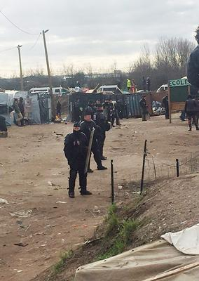 BEST QUALITY AVAILABLE  Handout file photo taken with permission from the Twitter feed of @GoodChanceCal of police in the Calais migrant camp known as the Jungle as demolition teams have moved in to start dismantling makeshift homes. PRESS ASSOCIATION Photo. Picture date: Monday February 29, 2016. A spokeswoman for the Help Refugees charity said police had blocked entrances to the sprawling camp, which is home to around 4,000 people. See PA story POLITICS Jungle. Photo credit should read: @GoodChanceCal/PA Wire  NOTE TO EDITORS: This handout photo may only be used in for editorial reporting purposes for the contemporaneous illustration of events, things or the people in the image or facts mentioned in the caption. Reuse of the picture may require further permission from the copyright holder.