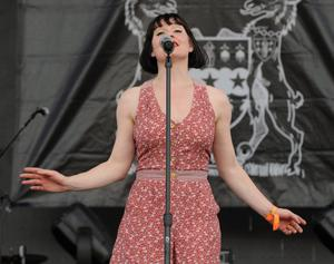 INDIO, CA - APRIL 12:  Musician Lorna Thomas of the band Skinny Lister performs during day 1 of the 2013 Coachella Valley Music & Arts Festival at the Empire Polo Club on April 12, 2013 in Indio, California.  (Photo by Kevin Winter/Getty Images for Coachella)