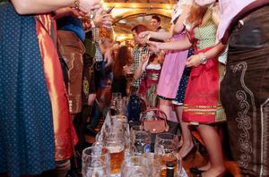 MUNICH, GERMANY - OCTOBER 05:  Revellers celebrate the last hour of the 2014 Oktoberfest on October 5, 2014 in Munich, Germany. The 181st Oktoberfest ends today, having drawn visitors from around the globe in the world's largest beer fest.  (Photo by Johannes Simon/Getty Images)