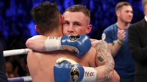 Carl Frampton embraces Nonito Donaire at the end of their epic 12-round bout in April 2018.