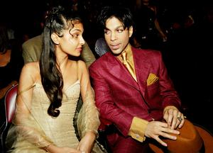 FILE - 21 APRIL 2016: Musician Prince has reportedly Died at 57 on April 21, 2016. HOLLYWOOD, CA - MARCH 6:  Singer Prince (R) and his wife Manuela Testolini sit in the audience at the 35th Annual NAACP Image Awards held at the Universal Amphitheatre, March 6, 2004 in Hollywood, California.  (Photo by Frank Micelotta/Getty Images)