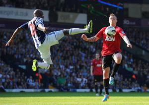 WEST BROMWICH, ENGLAND - MAY 19:  Youssuf Mulumbu of West Bromwich Albion battles with Alexander Buttner of Manchester United during the Barclays Premier League match between West Bromwich Albion and Manchester United at The Hawthorns on May 19, 2013 in West Bromwich, England.  (Photo by Michael Regan/Getty Images) *** BESTPIX ***