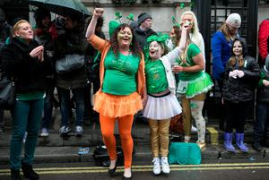 People celebrate at the Mayor of London's St Patrick's Day Parade and Festival in London. Daniel Leal-Olivas/PA Wire.