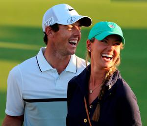 Rory McIlroy and Erica Stoll after winning the the DP World Tour Golf Championship in Dubai, on November 22, 2015.  (AFP PHOTO / KARIM SAHIBKARIM SAHIB/AFP/Getty Images)