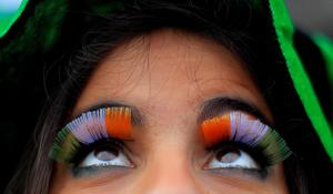 A woman wears false flag eyelashes during the St Patrick's day parade through Dublin city centre on St Patrick's day. PRESS ASSOCIATION Photo. Picture date: Sunday March 17, 2013. Photo credit should read: Julien Behal/PA Wire