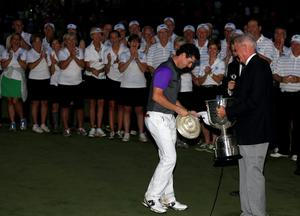 Rory McIlroy of Northern Ireland is awarded the Wanamaker trophy by PGA of America President, Ted Bishop, after his one-stroke victory during the final round of the 96th PGA Championship at Valhalla Golf Club on August 10, 2014 in Louisville, Kentucky.  (Photo by David Cannon/Getty Images)