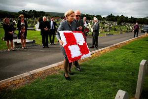 Polish MEP Anna Fotyga lays a wreath at the graves of seven Polish airmen, killed during the Second World War, at Milltown Cemetery, west Belfast.