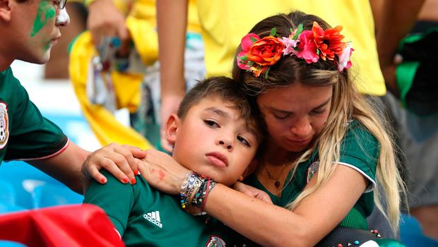 SAMARA, RUSSIA - JULY 02:  Mexico fans look dejected following their sides defeat in the 2018 FIFA World Cup Russia Round of 16 match between Brazil and Mexico at Samara Arena on July 2, 2018 in Samara, Russia.  (Photo by Ryan Pierse/Getty Images)